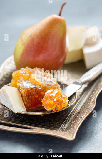 Delicious breakfast - brie, honey and pear. - Stock Image