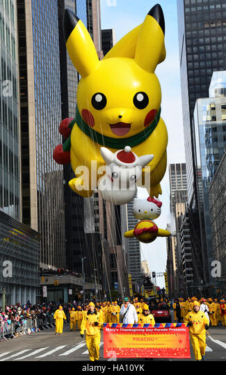 Pikachu Balloon fallowed by Hello Kitty on the parade route. - Stock Image
