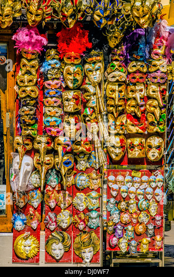 Carnival masks are very popular tourist souvenirs and are displayed in many small shops and street stalls. - Stock-Bilder