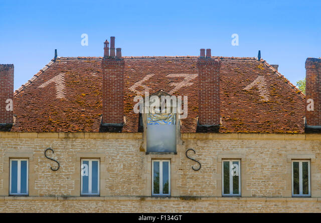1671 date in tiles on old mill roof, Yonne, France. - Stock Image