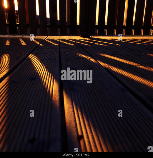 Shadows on decking - Stock Image