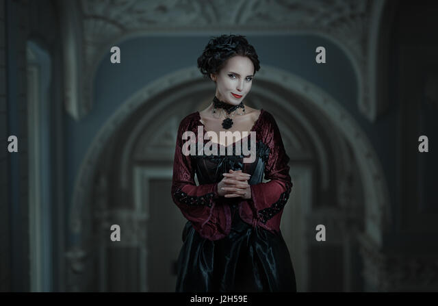 Portrait of a woman with a cunning grin on his face. - Stock Image