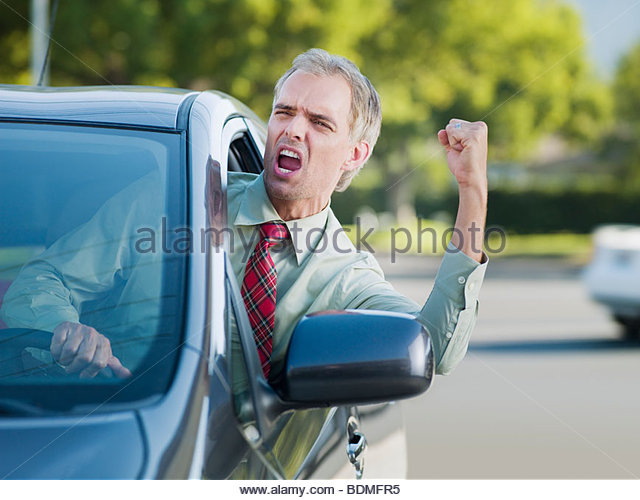 Angry driver shouting out car window - Stock Image