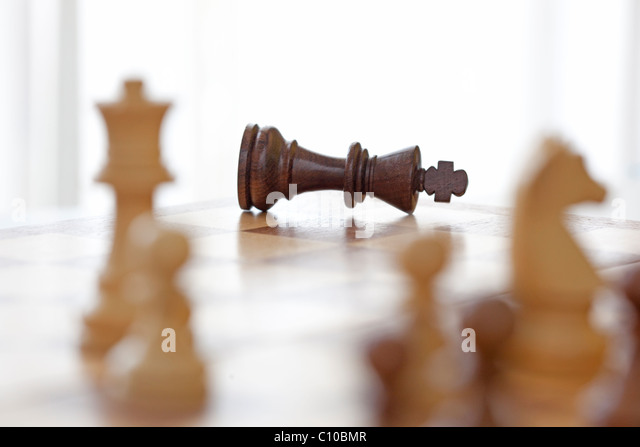king in chess game knocked down as loser. - Stock Image