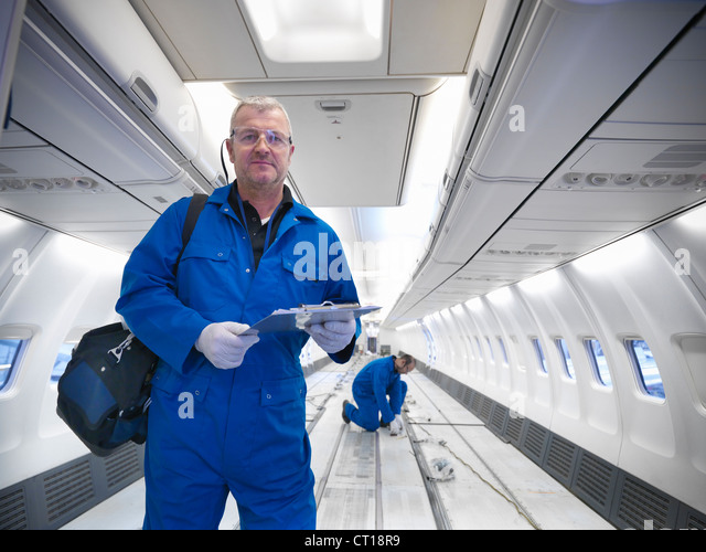 Workers in empty airplane - Stock Image
