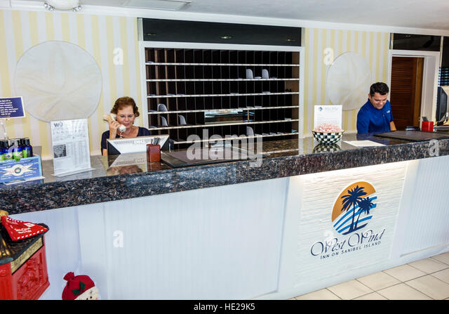 Sanibel Island Florida West Wind Inn hotel lobby front desk reservations employees - Stock Image
