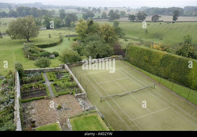 England UK Colridge Halton Castle 1382 pele tower view garden tennis court - Stock Image