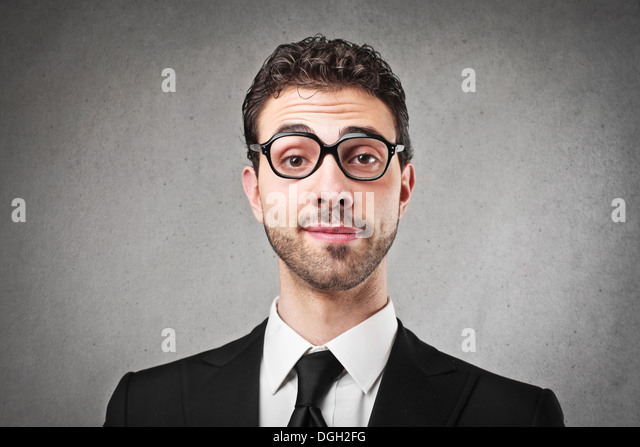 Young businessman with glasses and a strange expression - Stock Image