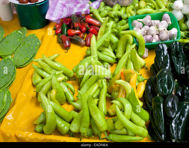 brightly colored Peppers in Market place in Mexican Village - Stock Image