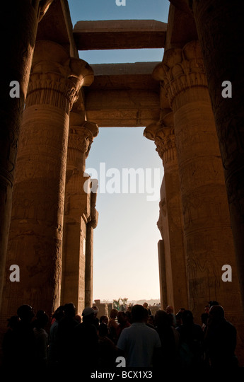 Egypt Kom Ombo temple hypostyle hall columns colonnade roof rests on pillars crowd of tourists - Stock Image