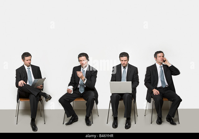 Businessmen with different objects - Stock Image