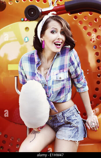 Lifestyle. Amusing Funny Girl with Cotton Candy Smiling - Stock Image