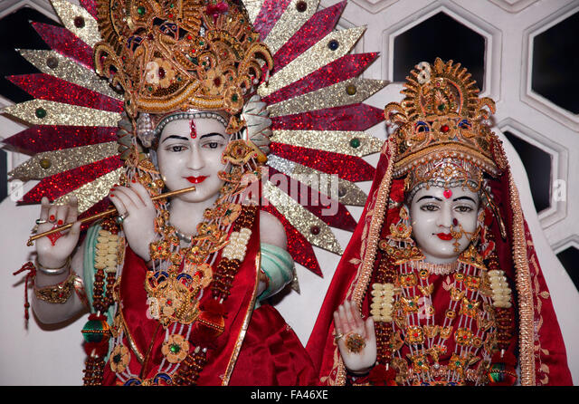 Lord Krishna and Radha on the shrine at a Hindu Temple, - Stock Image