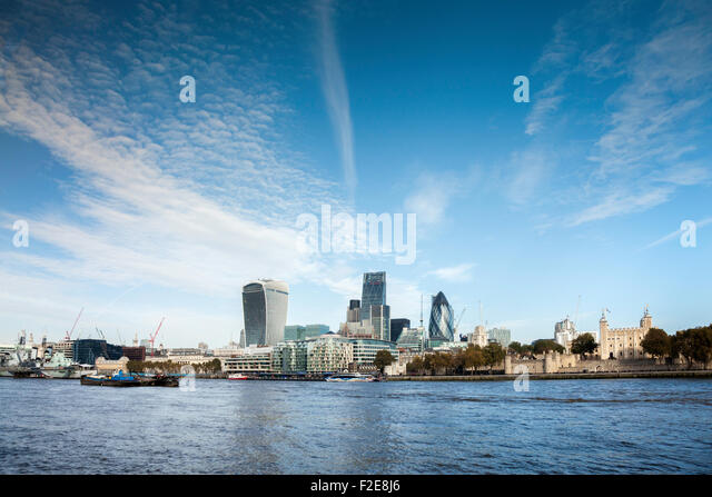 A London skyline image of the North Bank  buildings from across the River Thames in England. - Stock Image