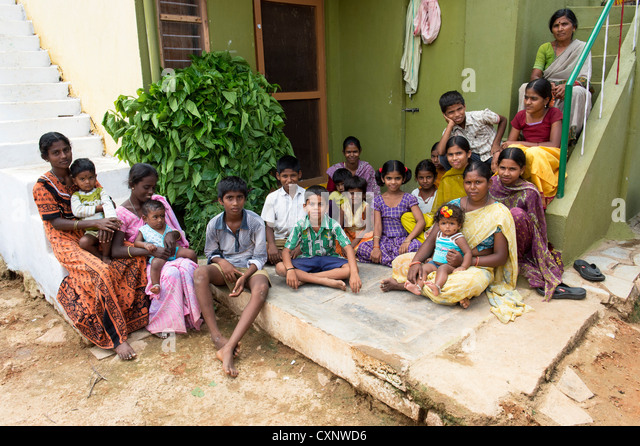 Group of indian villagers sitting outside an indian house in a rural indian village. Andhra Pradesh, India - Stock Image