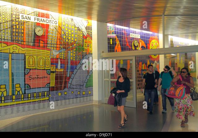 Nevada Las Vegas McCarran International Airport LAS terminal concourse gate area ceramic tile mural passengers - Stock Image