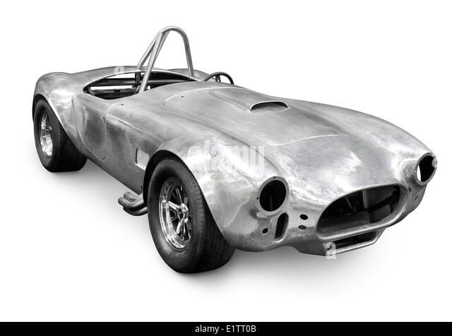 Polished lightweight aluminum body of a race car AC Cobra with stripped off paint. Isolated on white background - Stock Image