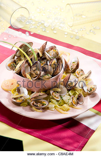 Confit citrus-flavored steam-cooked sea shells - Stock Image