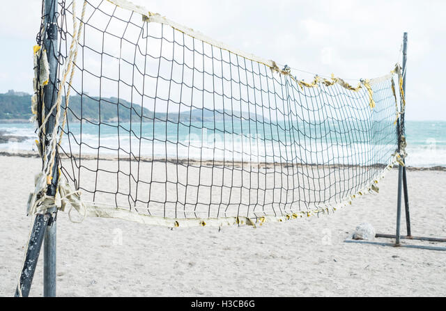 Beach volleyball net at Gyllyngvase (Gylly) beach, Falmouth Cornwall. - Stock Image