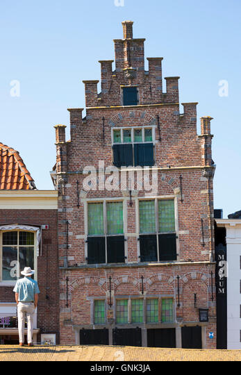 Tourist views traditional architecture lopsided ancient building of theTown Hall and Museum, Edam, The Netherlands - Stock Image