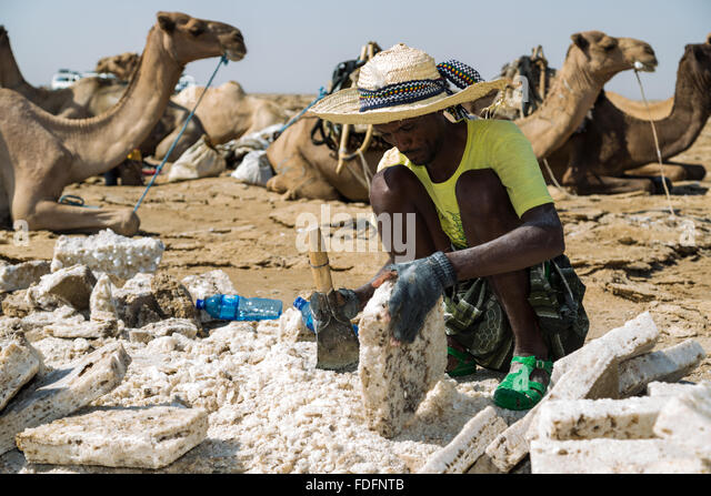 Local people mine salt from historic deposits in a way unchanged for milennia - Stock Image