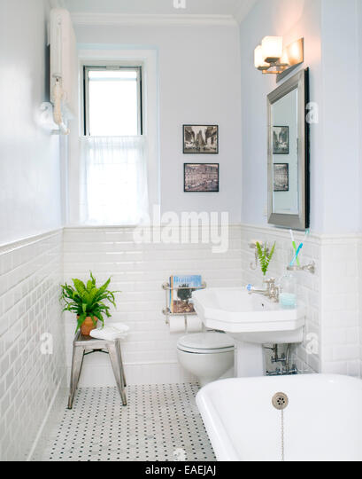 white tiled bathroom - Stock Image