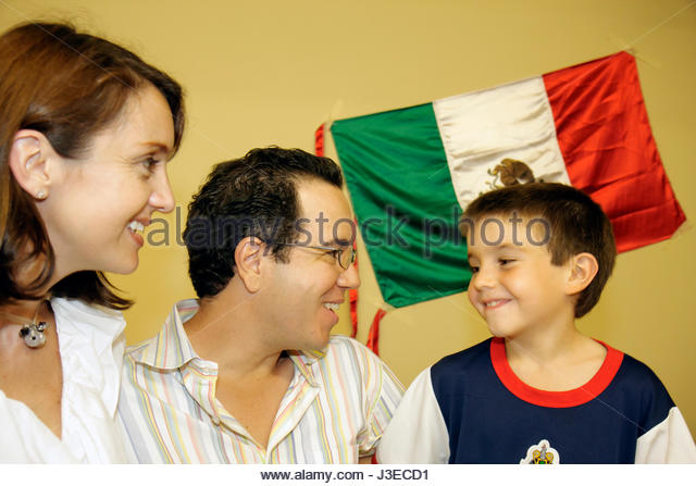 Miami Florida Miami Art Central Festival Mexico Miami Hispanic woman man boy child parents family flag fun celebration - Stock Image