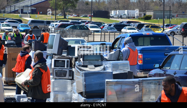 ANN ARBOR, MI - APRIL 26: Workers stack electronic equipment at an electronic recycling event in Ann Arbor, MI April - Stock Image