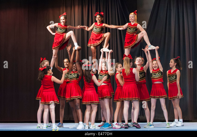 North West London junior cheer leading competition 2014 The Panthers team in acrobatic formation - Stock Image