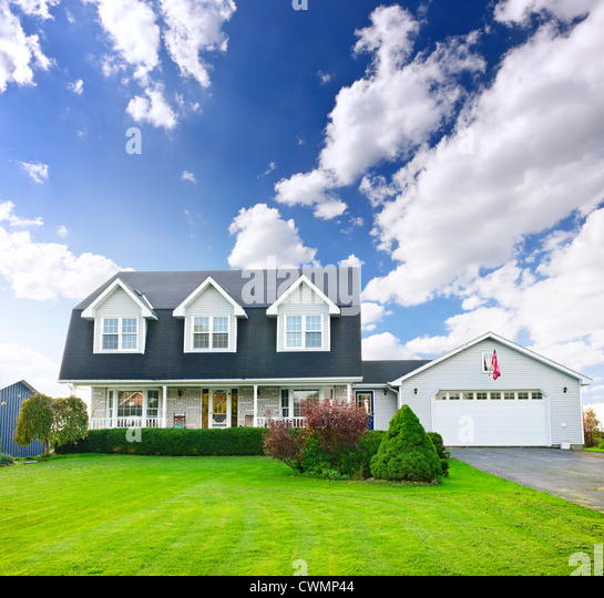 Beautiful two storey residential house with dormers and attached garage - Stock Image