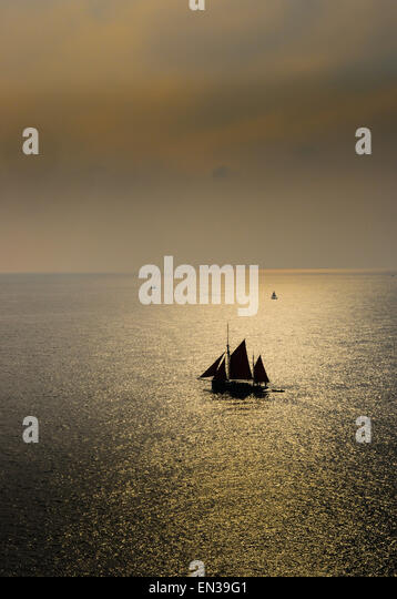The preserved British sailing trawler 'Provident' off the Devon coast. - Stock Image
