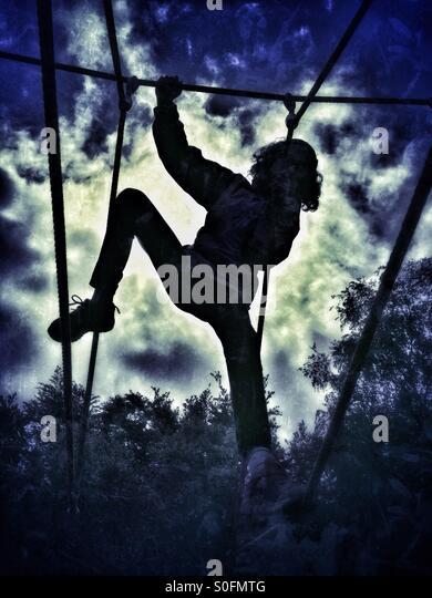 Girl on climbing frame - Stock Image