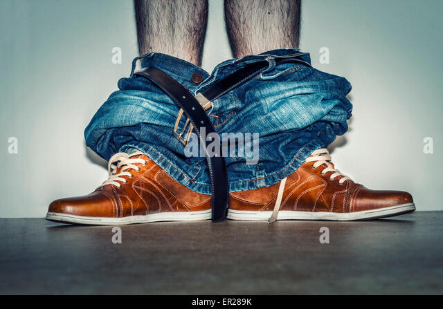 trousers on shoes legs - Stock Image