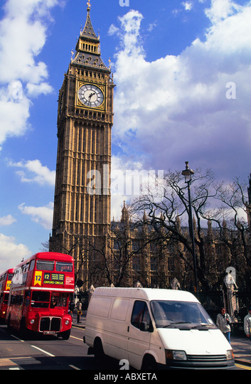 Europe United Kingdom Great Britain UK London England City of Westminster Big Ben and Traffic in Parliament Square - Stock Image