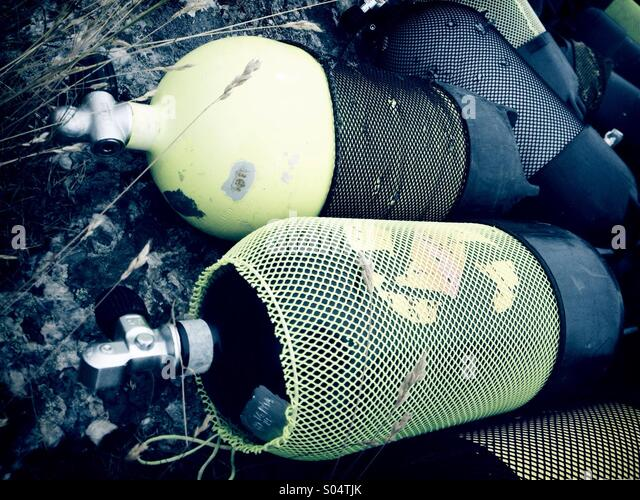Scuba diving aqualung air tanks lying on rocks. - Stock-Bilder