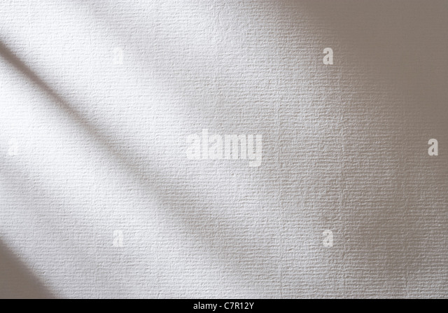 Shadows on textured white paper. - Stock Image