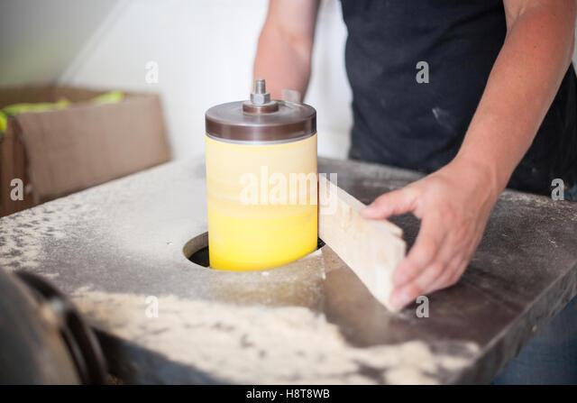 Close up detail of a furniture maker sanding a piece of wood - Stock-Bilder