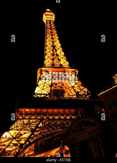 Eiffel Tower Paris Hotel and Casino Las Vegas strip skyline at night bright neon lights landmark building architecture - Stock Image