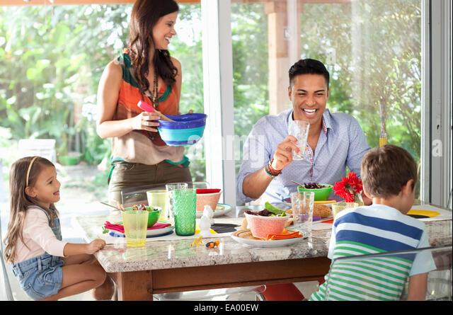 Family at dining table - Stock-Bilder