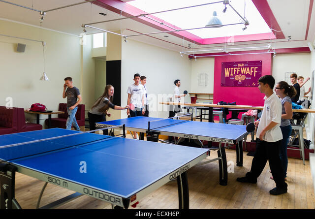 Teenagers playing table tennis in and after school club at the 'Wiff Waff Bar', a table tennis / Ping Pong - Stock Image