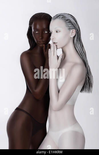 Ethnicity. Fantasy. Futuristic Women Painted White and Black. Art Bodypainting - Stock Image