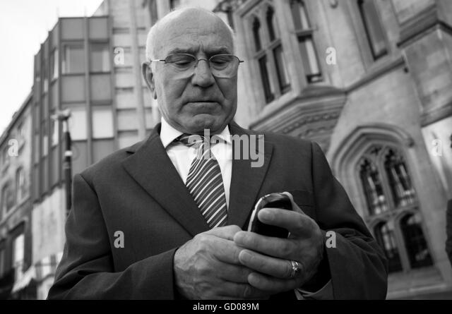 Oder gentleman using his mobile phone - Stock Image