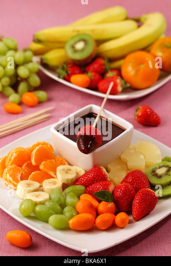 Fruit skewers with chocolate. Recipe available. - Stock Image