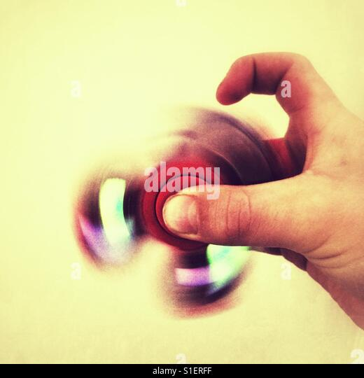Flashing fidget spinner toy - Stock Image