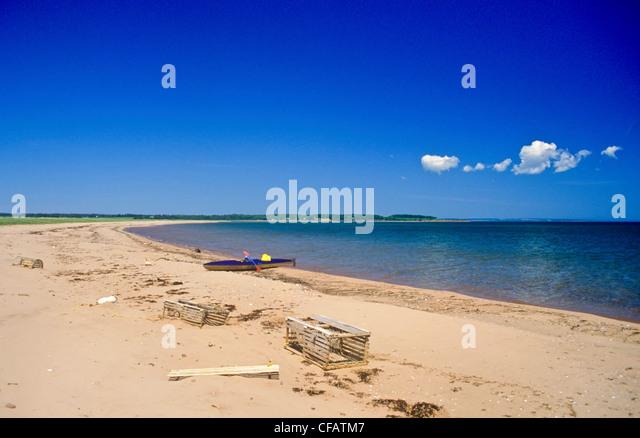 Empty kayak on the beach on Boughton Island, Prince Edward Island, Canada. - Stock Image