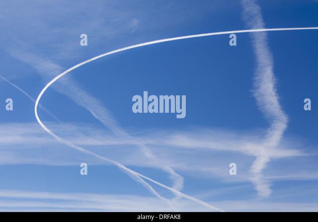 Washington state USA Jet trail across blue sky - Stock Image