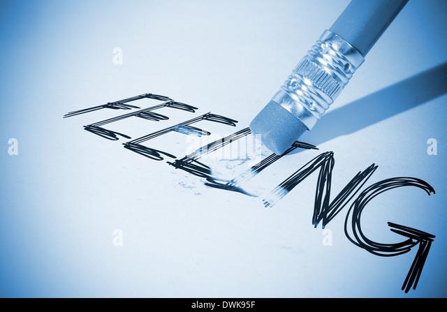 Pencil erasing the word Feeling - Stock Image
