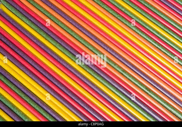 candy sticks in studio setting - Stock Image