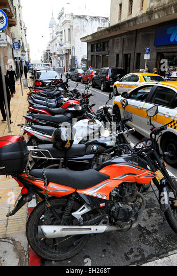 A line up of motorcycles parked on the street of Old Town Montevideo Uruguay. - Stock Image