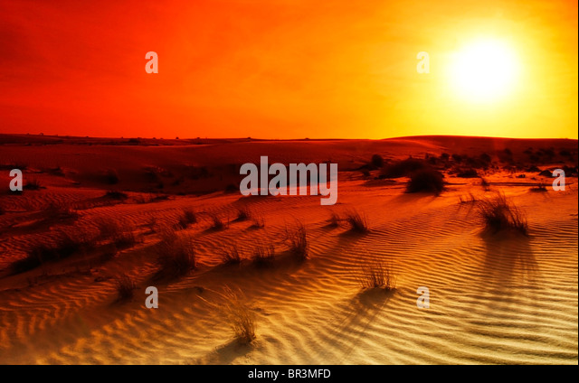 Extreme desert landscape with orange sunset - Stock Image